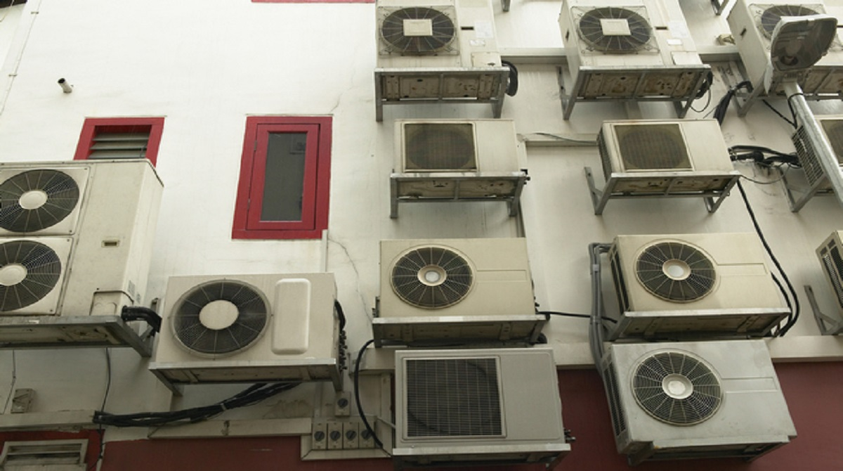 Low angle view of air conditioners mounted on a wall